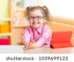 smart kid in spectacles reading ... | Shutterstock . vector #1039699123