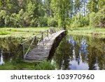 Wooden Bridge Over River With ...