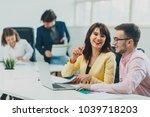 colleagues working at office in ... | Shutterstock . vector #1039718203