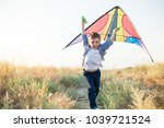 happy beautiful little boy... | Shutterstock . vector #1039721524