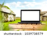 laptop on wooden box and... | Shutterstock . vector #1039738579