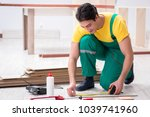 contractor working on laminate... | Shutterstock . vector #1039741960