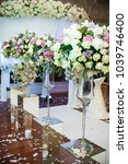 wedding decor with flowers in... | Shutterstock . vector #1039746400