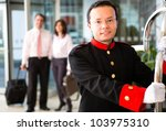 hotel bellboy carrying the... | Shutterstock . vector #103975310