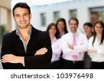 Successful man at the office leading a business team - stock photo