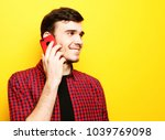 happy young man talking on cell ...   Shutterstock . vector #1039769098