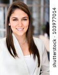 Friendly business woman at the office smiling - stock photo