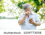 senior man trying to use a... | Shutterstock . vector #1039773058