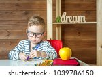 child in glasses doing his... | Shutterstock . vector #1039786150