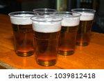 beer in plastic cups    Shutterstock . vector #1039812418