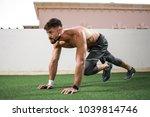 young shirtless muscular man... | Shutterstock . vector #1039814746