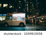 white food truck parked on city ... | Shutterstock . vector #1039815058