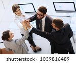 successful business team giving ... | Shutterstock . vector #1039816489