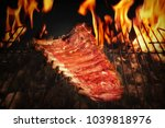 bbq pork ribs cooking on the... | Shutterstock . vector #1039818976