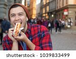 Ethnic Male Devouring A Hot Dog