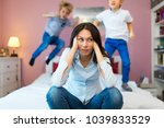 frustrated mother with children  | Shutterstock . vector #1039833529