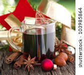 Hot spiced wine with several spices - stock photo