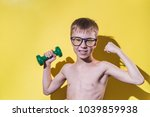 smiling small boy in glasses... | Shutterstock . vector #1039859938