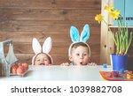 having fun on easter egg hunt....   Shutterstock . vector #1039882708