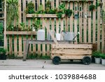 gardening equipment hanging on... | Shutterstock . vector #1039884688