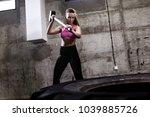 fitness woman hitting wheel... | Shutterstock . vector #1039885726