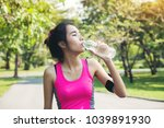 young woman running and... | Shutterstock . vector #1039891930