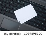 laptop and business cards ... | Shutterstock . vector #1039895320