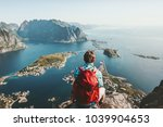 man sitting on cliff edge alone ... | Shutterstock . vector #1039904653