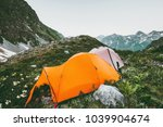 mountains and camping tents...   Shutterstock . vector #1039904674
