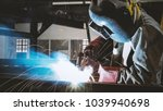 welding with sparks by process... | Shutterstock . vector #1039940698
