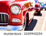 classic car headlights close up | Shutterstock . vector #1039943254