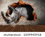 rhinoceros breaks the wall and... | Shutterstock . vector #1039945918