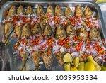 food stall in a market in krabi ... | Shutterstock . vector #1039953334
