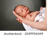 baby in mother's arms and...   Shutterstock . vector #1039956349