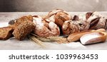 different kinds of bread and... | Shutterstock . vector #1039963453