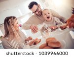 family of three having... | Shutterstock . vector #1039966000