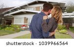 couple shown from behind... | Shutterstock . vector #1039966564