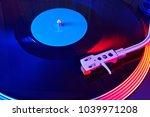 turntable vinyl record player.... | Shutterstock . vector #1039971208