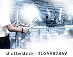 engineer hand using tablet with ... | Shutterstock . vector #1039982869