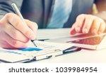 businessman working on laptop | Shutterstock . vector #1039984954