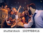 group of friends celebrating at ... | Shutterstock . vector #1039988416