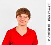 portrait of smiling teenage boy ... | Shutterstock . vector #1039991194