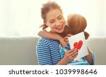 happy mother's day  child... | Shutterstock . vector #1039998646