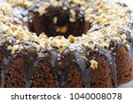 chocolate cake  sliced  covered ... | Shutterstock . vector #1040008078
