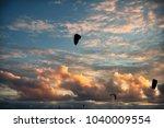kitesurfing at sunset  kite... | Shutterstock . vector #1040009554