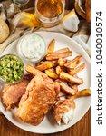 traditional fish in beer batter ... | Shutterstock . vector #1040010574