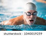 Senior Man Swimming In An...