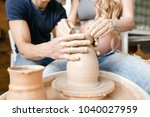 hands together make ceramics... | Shutterstock . vector #1040027959
