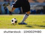 soccer player goalkeeper kick... | Shutterstock . vector #1040029480