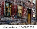 shabby old wooden red abandon...   Shutterstock . vector #1040029798